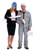 Female architect stood with decorator — Stock Photo
