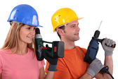 Tradespeople holding power tools — Стоковое фото