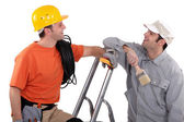 A house painter and an electrician laughing — Stock Photo