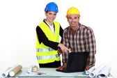 Architect and builder with laptop — Stock Photo