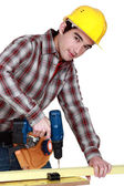 Man drilling wood — Stock Photo