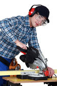 Craftsman cutting wood — Stock Photo