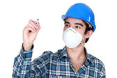 Worker wearing a face mask and holding a felt-tip pen — Stock Photo