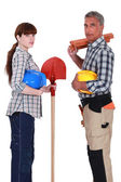Male and female roofers stood together — Stock Photo