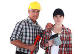 Tradespeople holding tools — Stock Photo
