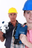 Man and woman carpenters — Stock Photo