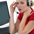 Blond receptionist suffering from headache — Stock Photo #9960975