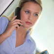 Office clerk answering the telephone — Stock Photo