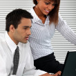 Man and woman sitting with computer — Stock Photo