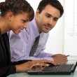 Young businessman and businesswoman working together — Stock Photo #9961563