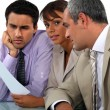 Three professionals in meeting — Stock Photo #9961665
