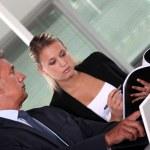 Boss and secretary interacting — Stock Photo