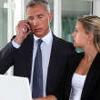 Boss working closely with female colleague — Stock Photo #9961818