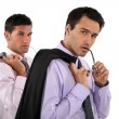 Businessmen with their jackets over their shoulders — Stock Photo