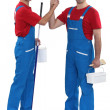 Craftsman painter and his apprentice shaking hands — Stock Photo #9963024