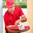 Delivery man with pizza boxes — Stock Photo