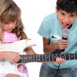 Stock Photo: Children singing and playing music