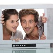Couple in an empty television screen — Stock Photo #9968472