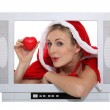 Alluring mother Christmas advertising for TV set — Stock Photo #9968736