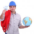 Plumber with a globe and handful of money — Stock Photo