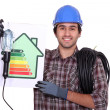 Stock Photo: Electricishowing energy class chart