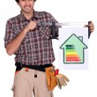 Stock Photo: Craftsmshows house with energy rating