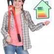 Stock Photo: Woman with an energy rating sign