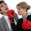 Stock Photo: Wompunching her colleague