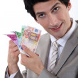 Stock Photo: Banker holding bank notes