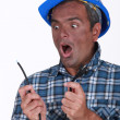 Stock Photo: Shocked electrician