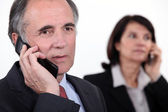 Executives on the phone — Stock Photo
