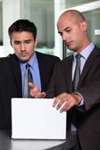 Businessman showing his associate a report — Stock Photo