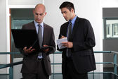 Two young businessmen working together — Stock Photo