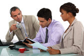 Three having a business meeting — Stock Photo