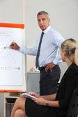 Businessman presenting a flipchart — Stock Photo