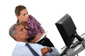 Businessman and his assistant looking at a computer — Stock Photo
