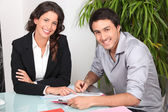 Customer signing contract agreement — Stockfoto