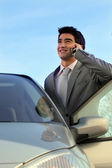 Businessman stood by his car making telephone call — Stock Photo