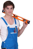 Young man with a spirit level — Stock Photo