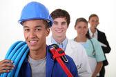 Fyra arbetstagare med olika yrken — Stockfoto