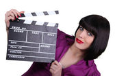 Woman holding up a clapperboard — 图库照片
