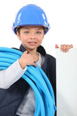 Little girl dressed as electrician — Stock Photo