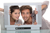 Couple in an empty television screen — Stock Photo