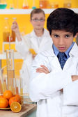 Angry child in laboratory — Stock Photo