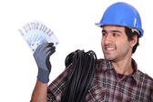 Craftsman holding money in cash — Stock Photo