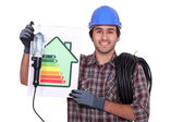 An electrician showing energy class chart — Stock Photo