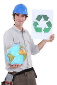 Tradesman promoting recycling in the world — Stock Photo