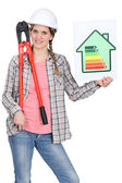 Woman with an energy rating sign — Stock Photo