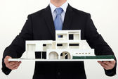 Architect holding scale replica of building — Stock Photo
