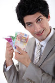 Banker holding bank notes — Stock Photo